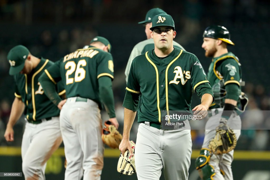 Andrew Triggs #60 of the Oakland Athletics exits the game shortly after giving up a three-run home run to Nelson Cruz of the Seattle Mariners in the fifth inning to give the Mariners a 4-1 lead during their game at Safeco Field on May 1, 2018 in Seattle, Washington.