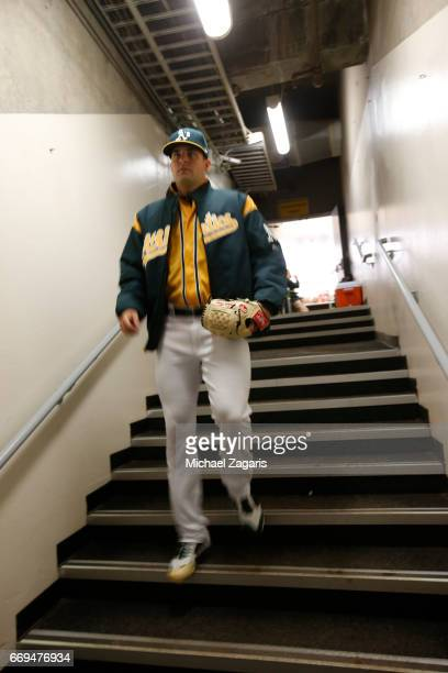 Andrew Triggs of the Oakland Athletics heads to the field prior to the game against the Los Angeles Angels of Anaheim at the Oakland Alameda Coliseum...