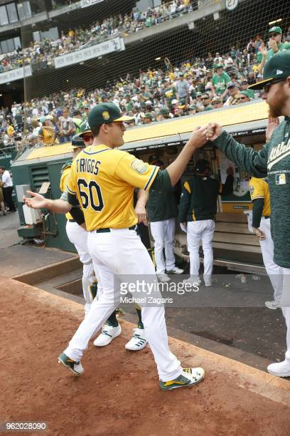 Andrew Triggs of the Oakland Athletics is greeted at the dugout during the game against the Baltimore Orioles at the Oakland Alameda Coliseum on May...