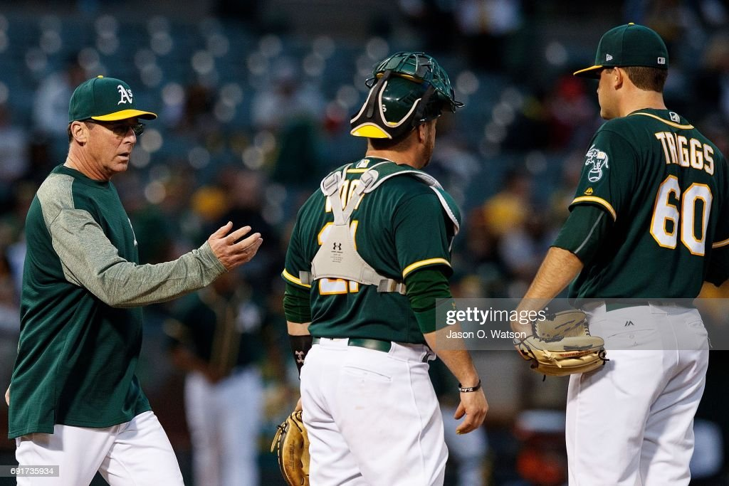 Andrew Triggs #60 of the Oakland Athletics is relieved by manager Bob Melvin #6 during the fourth inning against the Washington Nationals at the Oakland Coliseum on June 2, 2017 in Oakland, California. The Washington Nationals defeated the Oakland Athletics 13-3.
