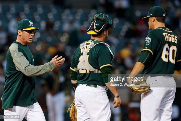 Andrew Triggs of the Oakland Athletics is relieved by manager Bob Melvin during the fourth inning against the Washington Nationals at the Oakland...