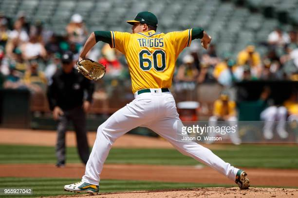 Andrew Triggs of the Oakland Athletics pitches against the Baltimore Orioles during the second inning at the Oakland Coliseum on May 6 2018 in...
