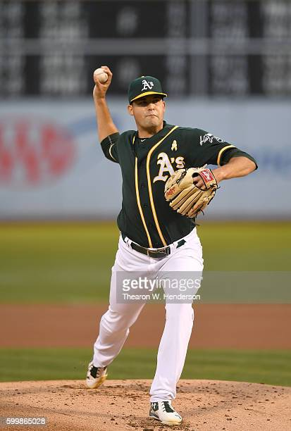 Andrew Triggs of the Oakland Athletics pitches against the Boston Red Sox in the top of the first inning at OaklandAlameda County Coliseum on...