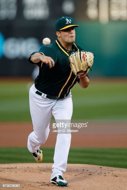 Andrew Triggs of the Oakland Athletics pitches against the Texas Rangers during the first inning at the Oakland Coliseum on April 18 2017 in Oakland...