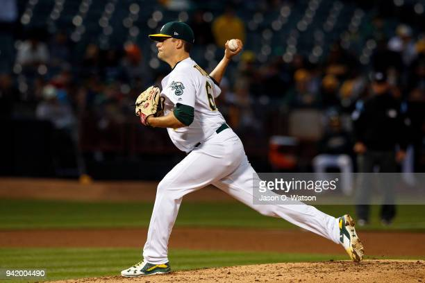 Andrew Triggs of the Oakland Athletics pitches against the Texas Rangers during the second inning at the Oakland Coliseum on April 2 2018 in Oakland...