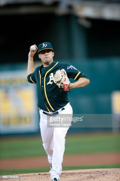 Andrew Triggs of the Oakland Athletics pitches during the game against the Texas Rangers at the Oakland Alameda Coliseum on April 18 2017 in Oakland...