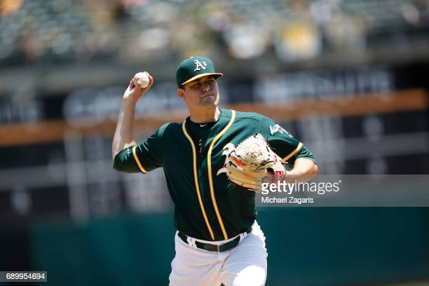 Andrew Triggs of the Oakland Athletics pitches during the game against the Los Angeles Angels of Anaheim at the Oakland Alameda Coliseum on May 10...