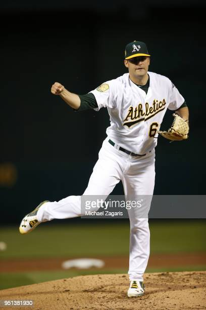 Andrew Triggs of the Oakland Athletics pitches during the game against the Texas Rangers at the Oakland Alameda Coliseum on April 2 2018 in Oakland...