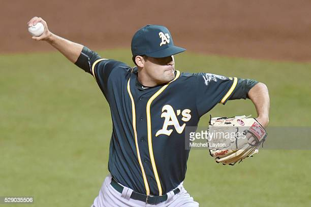 Andrew Triggs of the Oakland Athletics pitches in the eighth inning and strikes out the side during game two of a double header baseball game against...