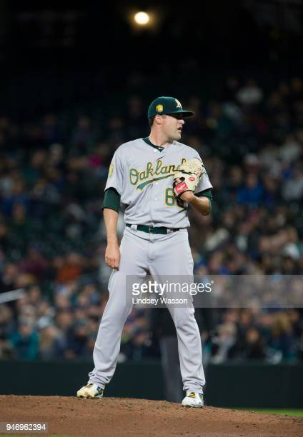 Andrew Triggs of the Oakland Athletics prepares to pitch in the third inning against the Seattle Mariners on April 13 2018 in Seattle Washington The...