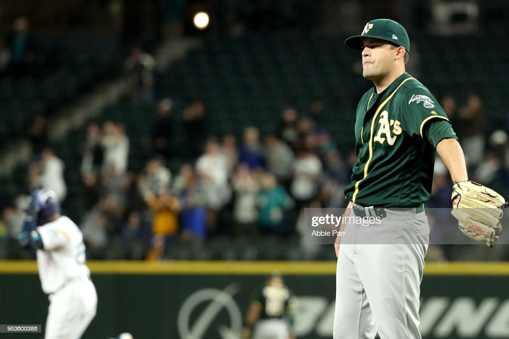Andrew Triggs #60 of the Oakland Athletics reacts after giving up a three-run home run to Nelson Cruz #23 of the Seattle Mariners in the fifth inning to give the Mariners a 4-1 lead during their game at Safeco Field on May 1, 2018 in Seattle, Washington.
