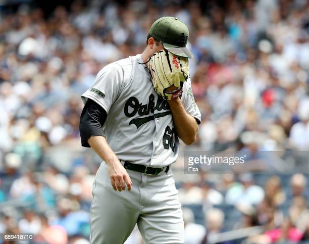 Andrew Triggs of the Oakland Athletics reacts into his glove after the third inning against the New York Yankees on May 28 2017 at Yankee Stadium in...