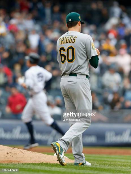 Andrew Triggs of the Oakland Athletics rubs up a new ball after surrendering a fifth inning two run home run against Aaron Judge of the New York...