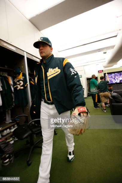 Andrew Triggs of the Oakland Athletics stands in the clubhouse prior to the game against the Seattle Mariners at the Oakland Alameda Coliseum on...