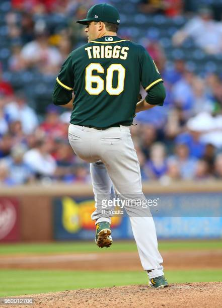 Andrew Triggs of the Oakland Athletics throws in the second inning against the Oakland Athletics at Globe Life Park in Arlington on April 24 2018 in...