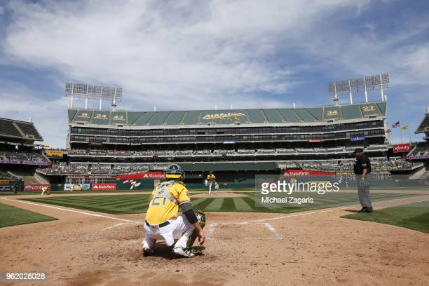 Andrew Triggs of the Oakland Athletics warms up from the mound during the game against the Baltimore Orioles at the Oakland Alameda Coliseum on May 6...
