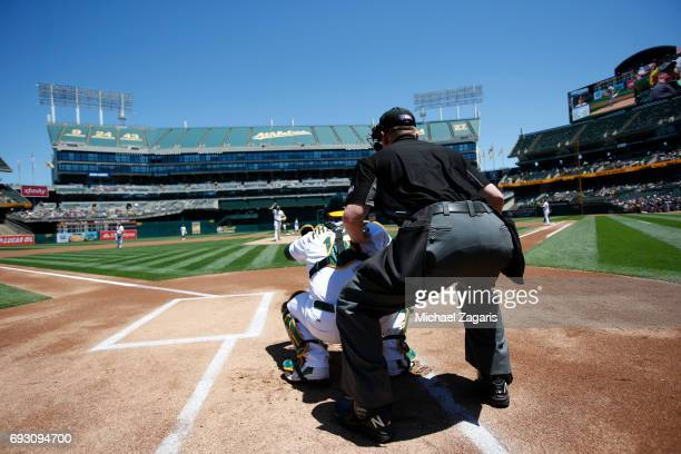 Andrew Triggs of the Oakland Athletics warmsup from the mound prior to the game against the Boston Red Sox at the Oakland Alameda Coliseum on May 21...