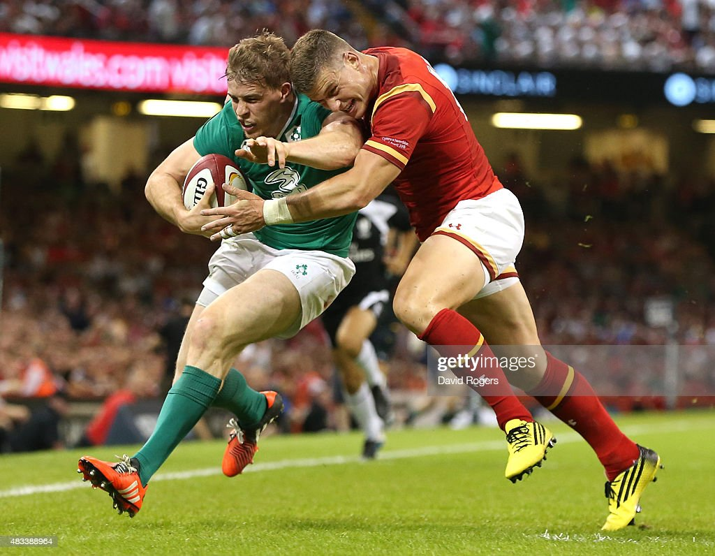 Andrew Trimble of Ireland is knocked into touch by Wales centre Scott Williams during the International match between Wales and Ireland at the Millennium Stadium on August 8, 2015 in Cardiff, Wales.