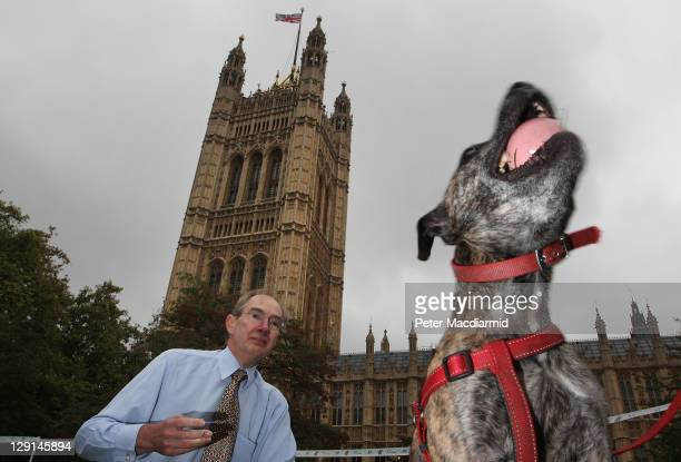 Andrew Turner MP throws a ball for his staffordshire bull terrier Pickle during the Westminster Dog of The Year competition in Victoria Tower Gardens...