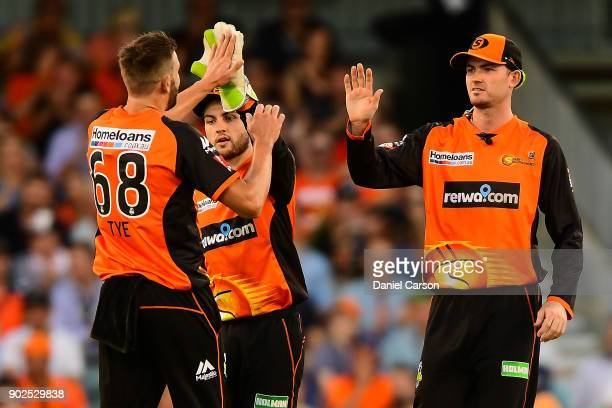 Andrew Tye and Ashton Turner of the Perth Scorchers celebrate taking the wicket of Marcus Harris of the Melbourne Renegades during the Big Bash...