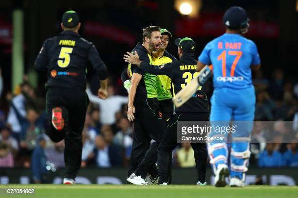 Andrew Tye of Australia celebrates dismissing Rishabh Pant of India during the International Twenty20 match between Australia and India at Sydney...