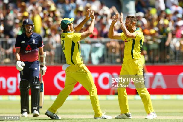 Andrew Tye of Australia celebrates getting the final wicket with team mate Mitchell Marsh during game five of the One Day International match between...