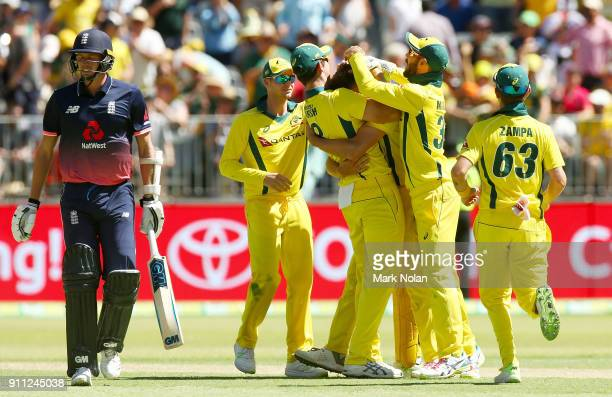 Andrew Tye of Australia celebrates getting the final wicket with team mates during game five of the One Day International match between Australia and...