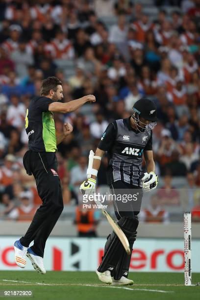 Andrew Tye of Australia celebrates his dismissal of Mitchell Santner of New Zealand during the International Twenty20 Tri Series Final match between...