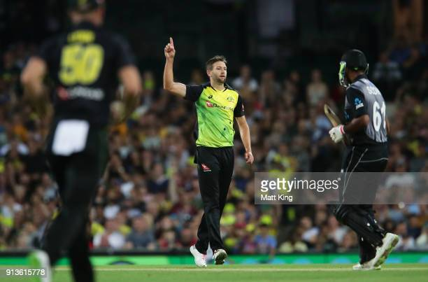 Andrew Tye of Australia celebrates taking the wicket of Ish Sodhi of New Zealand during game one of the International Twenty20 series between...