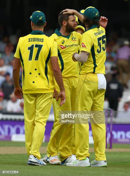 Andrew Tye of Australia celebrates the wicket of England's Jos Buttler during One Day International Series match between England and Australia at Kia...