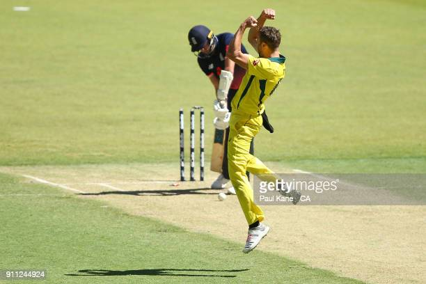 Andrew Tye of Australia celebrates the wicket of Jake Ball of England during game five of the One Day International match between Australia and...