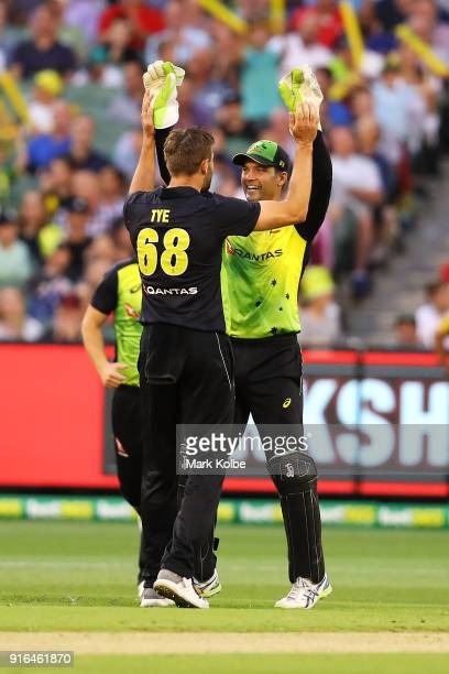 Andrew Tye of Australia celebrates with Alex Carey of Australia after taking the wicket of James Vince of England during game two of the...