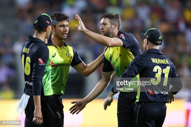Andrew Tye of Australia celebrates with his team after taking the wicket of Tom Curran of England during the Twenty20 International match between...
