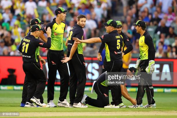 Andrew Tye of Australia celebrates with his team mates after taking the wicket of James Vince of England during game two of the International...