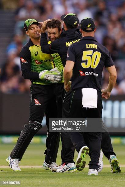 Andrew Tye of Australia celebrates with teammates after bowling James Vince of England during game two of the International Twenty20 series between...