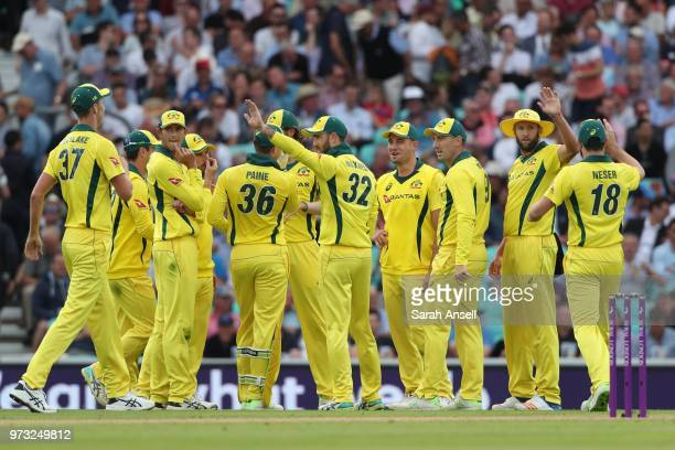 Andrew Tye of Australia celebrates with teammates after dismissing England's Jos Buttler during the 1st Royal London ODI between England and...