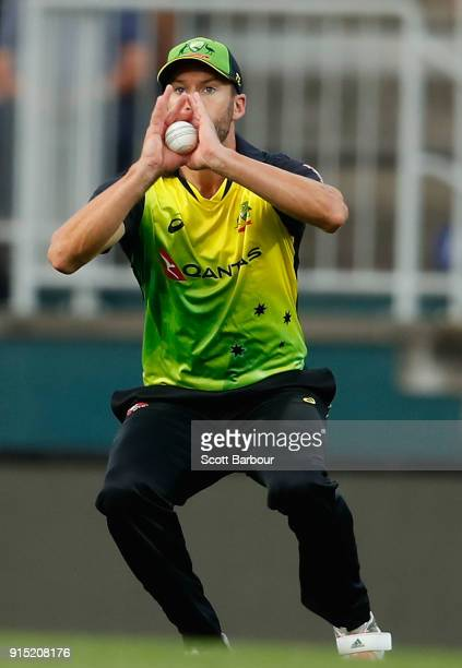 Andrew Tye of Australia takes a catch to dimiss Jason Roy of England during the Twenty20 International match between Australia and England at...