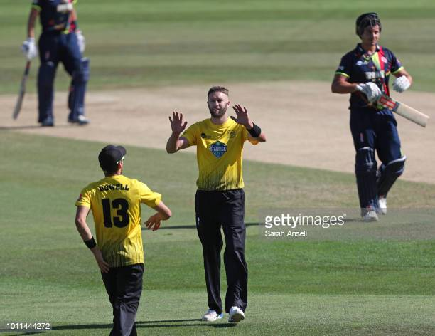 Andrew Tye of Gloucestershire celebrates after dismissing the dangerous Marcus Stoinis of Kent Spitfires during the Vitality Blast match between Kent...