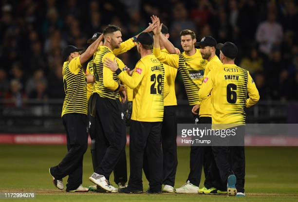 Andrew Tye of Gloucestershire celebrates after taking the wicket of Luis Reece of Derbyshire during the Vitality T20 Blast match between...