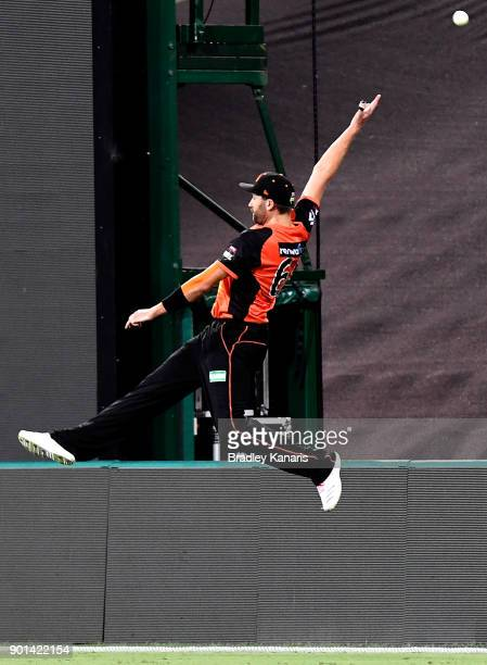 Andrew Tye of the Scorchers attempts to take a catch during the Big Bash League match between the Brisbane Heat and the Perth Scorchers at The Gabba...