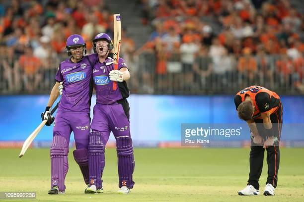 Andrew Tye of the Scorchers reacts while Johan Botha and James Faulkner of the Hurricanes celebrate winning the Big Bash League match between the...