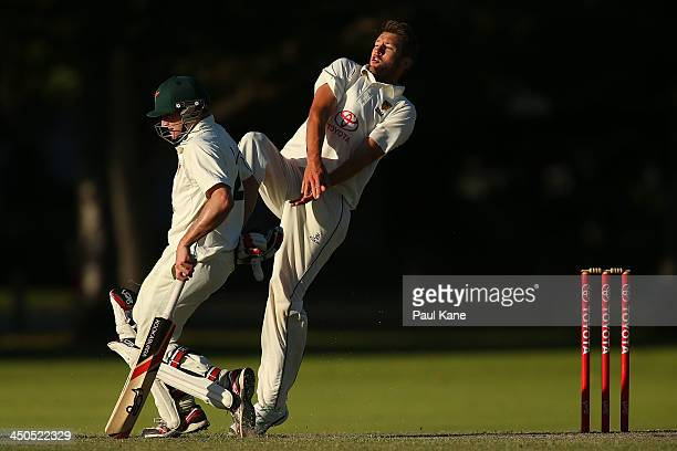 Andrew Tye of Western Australia and Steve Cazzulino of Tasmania avoid a return throw to the non strikers endduring day two of the Futures League...