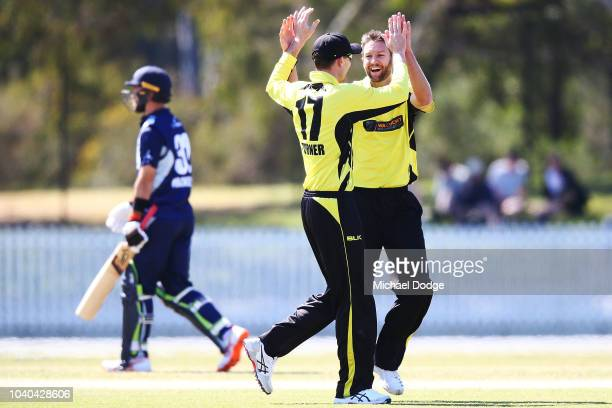 Andrew Tye of Western Australia celebrates the wicket of Glenn Maxwell of Victoria with Ashton Turner of Western Australia during the JLT One Day Cup...