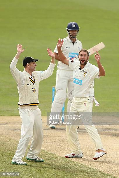 Andrew Tye of Western Australia celebrates with teammates after taking the wicket of Rob Quiney of Victoria during day five of the Sheffield Shield...
