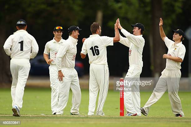 Andrew Tye of Western Australia is congratulated after dismissing Henry Terry of Tasmania during day one of the Futures League match between Western...