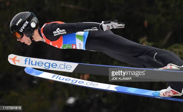 Andrew Urlaub from the US soars through the air during the men's HS130 ski jumping team event at the FIS Nordic World Ski Championships in Innsbruck...
