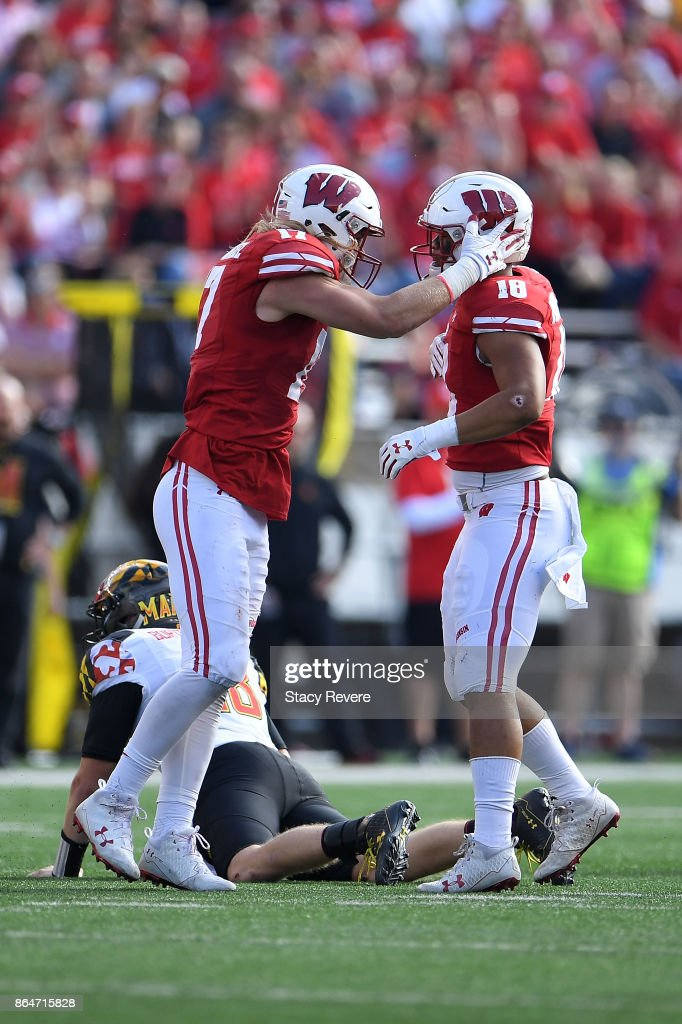 Andrew Van Ginkel #17 of the Wisconsin Badgers celebrates a sack with Arrington Farrar #18 during a game against the Maryland Terrapins at Camp Randall Stadium on October 21, 2017 in Madison, Wisconsin.