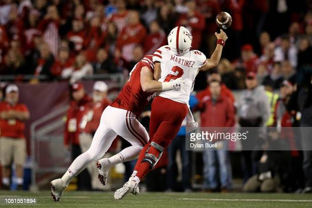 Andrew Van Ginkel of the Wisconsin Badgers hits Adrian Martinez of the Nebraska Cornhuskers as he throws a pass in the second quarter at Camp Randall...