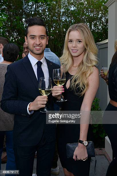 Andrew Waldan and Ashley Getchman attend the Hamptons Magazine Celebration of Memorial Day Cover Star Heidi Klum on May 24 2014 in Southampton New...