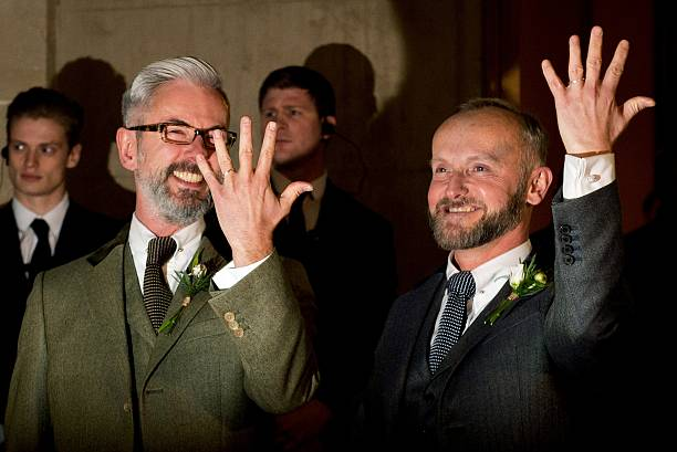 Andrew Wale L And Neil Allard Show Their Wedding Rings Following At